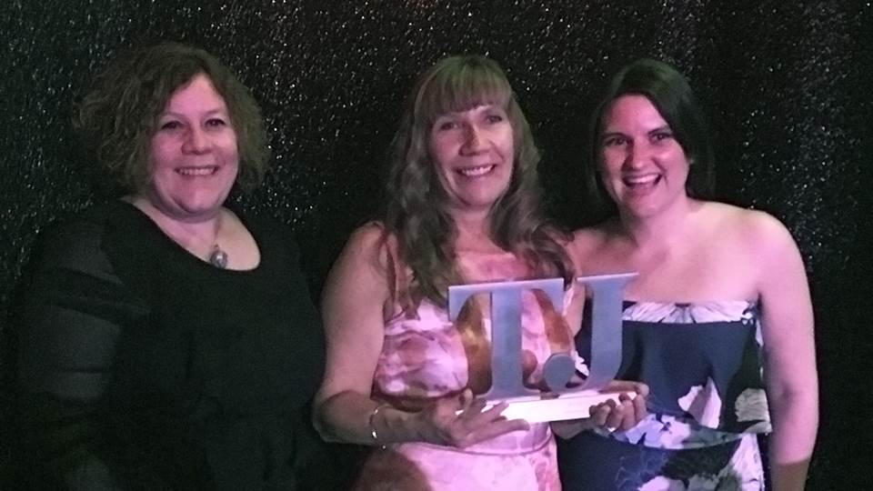 Sarah Baker, Hayley Khan and Alison Humphries receiving the gold award