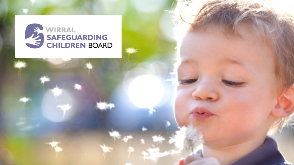 child blowing a dandelion with logo