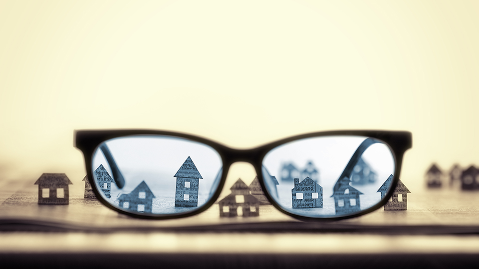glasses next to houses