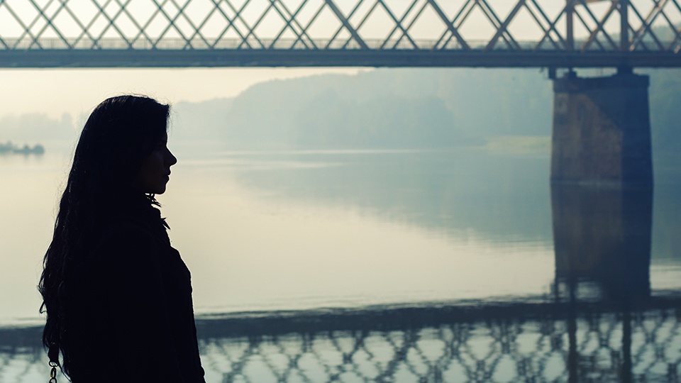 Girl looking across over bridge