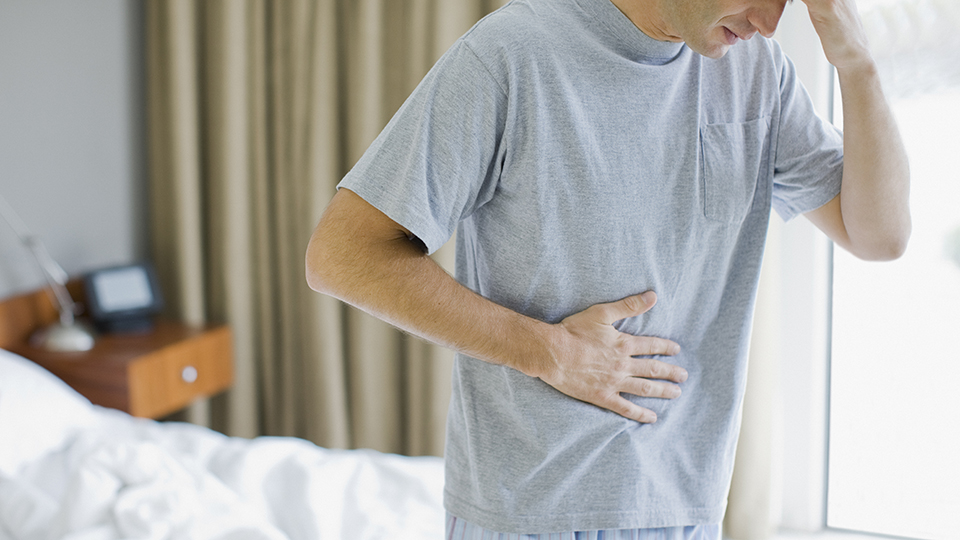 Man in hospital with stomach pain