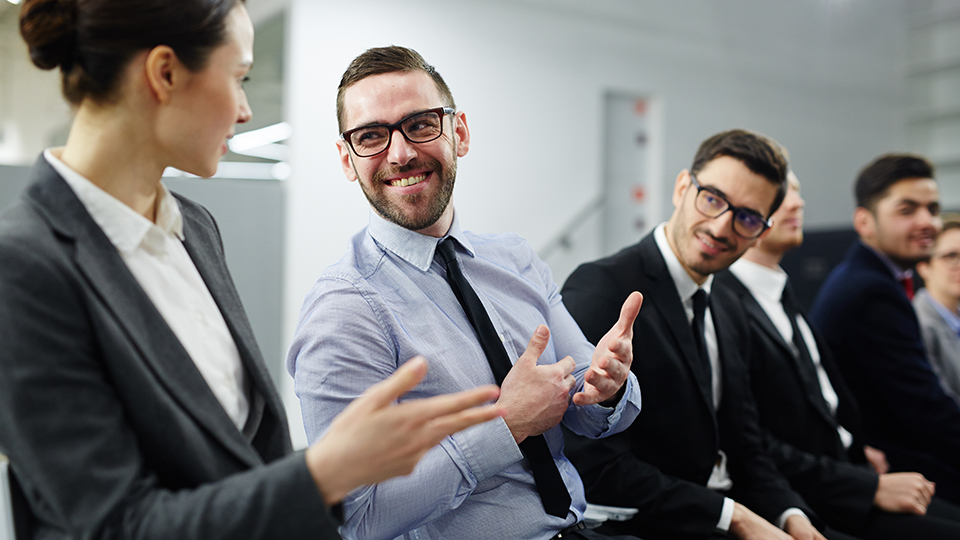 Enthusiastic employee talking in meeting