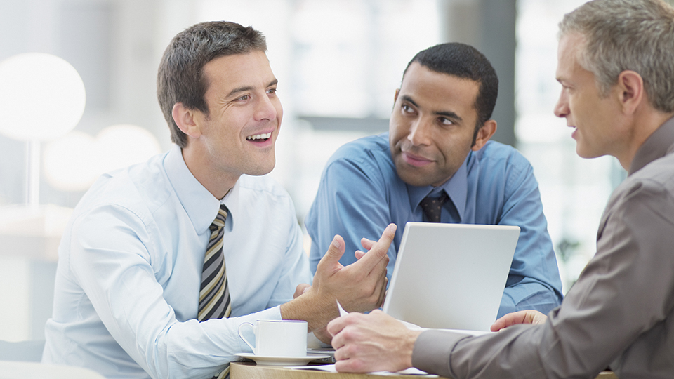 Business men talking in meeting