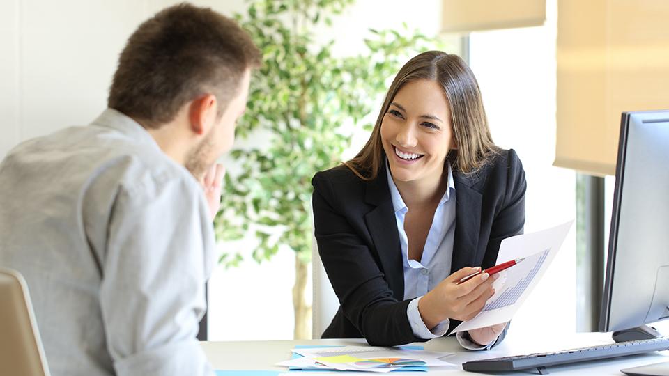 Staff speaking to customer