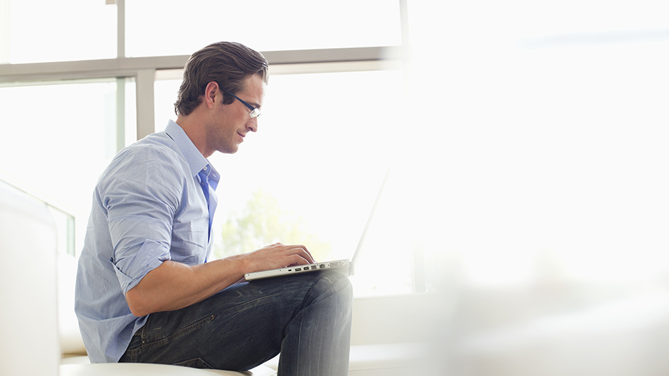 Man working from computer at home