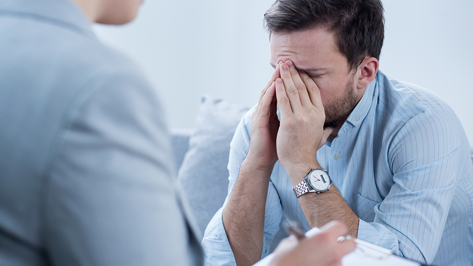 Man crying during therapy