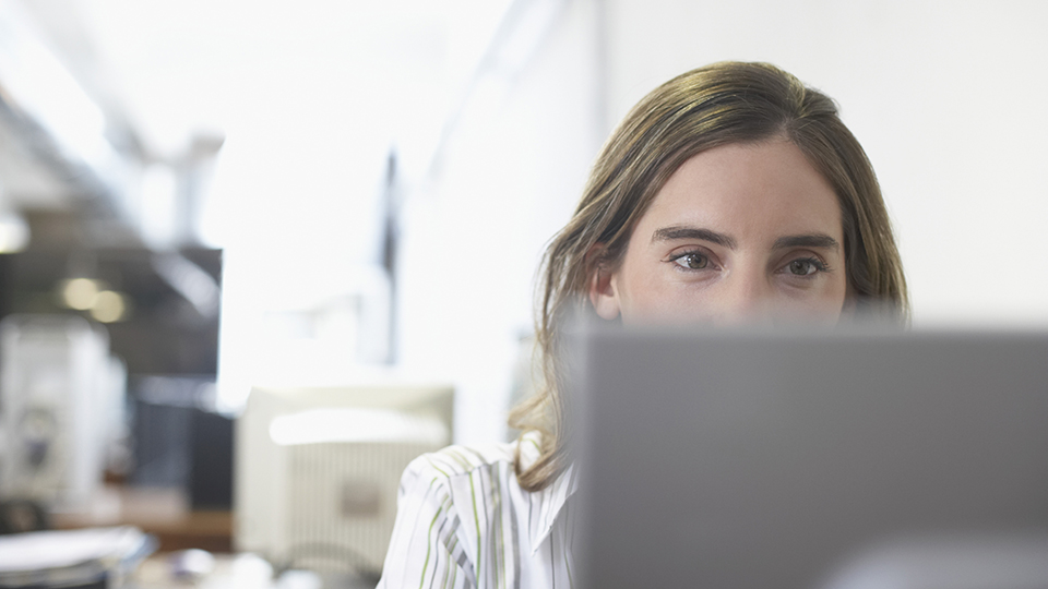 Lady looking at computer screen