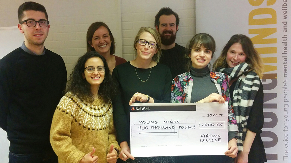 Members of the YoungMinds team receive Virtual College's donation