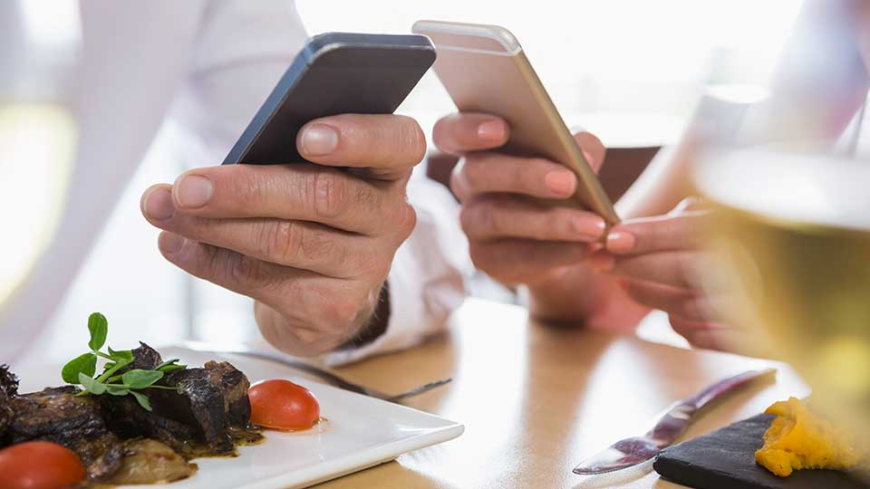 Chefs using their mobile phones