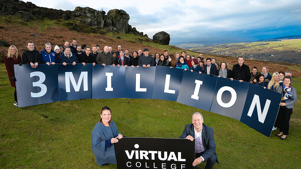 Virtual College staff celebrate at the cow and calf rocks