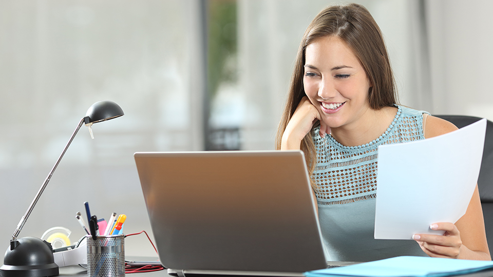 Young woman working at a laptop.